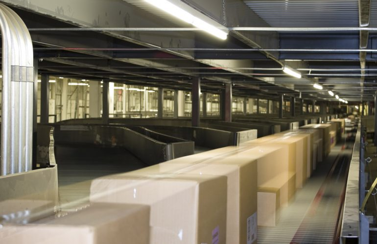 Conveyor with boxes